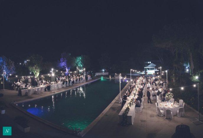 pool wedding by night